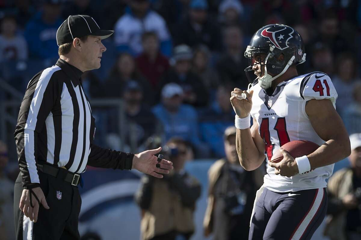 Texans running back Jonathan Grimes (41) asks the official if he can keep the ball after scoring his first career touchdown.