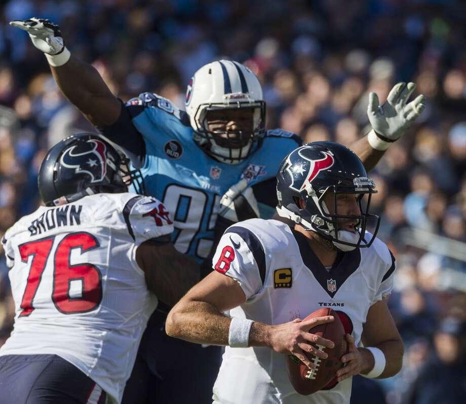 Texans quarterback Matt Schaub (8) is pressured by Titans defensive end Kamerion Wimbley (95). Photo: Smiley N. Pool, Houston Chronicle