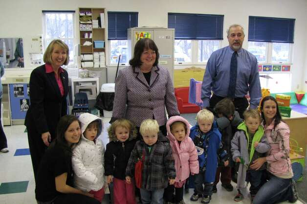 Rensselaer County officials including County Executive Kathleen M. Jimino, county outreach worker Jean Brooks and Deputy Commissioner for Youth Pierce Hoyt visit a class of Head Start students from the Hoosick Falls Family Resource Center of the Commission of Economic Opportunity, who just received their new winter coats through the county?s Coats for Kids Program. This year the program bought and distributed 741 coats using funds raised through a summertime golf outing. Since 2001 nearly 4,500 coats have been distributed.  (Christopher J. Meyer)