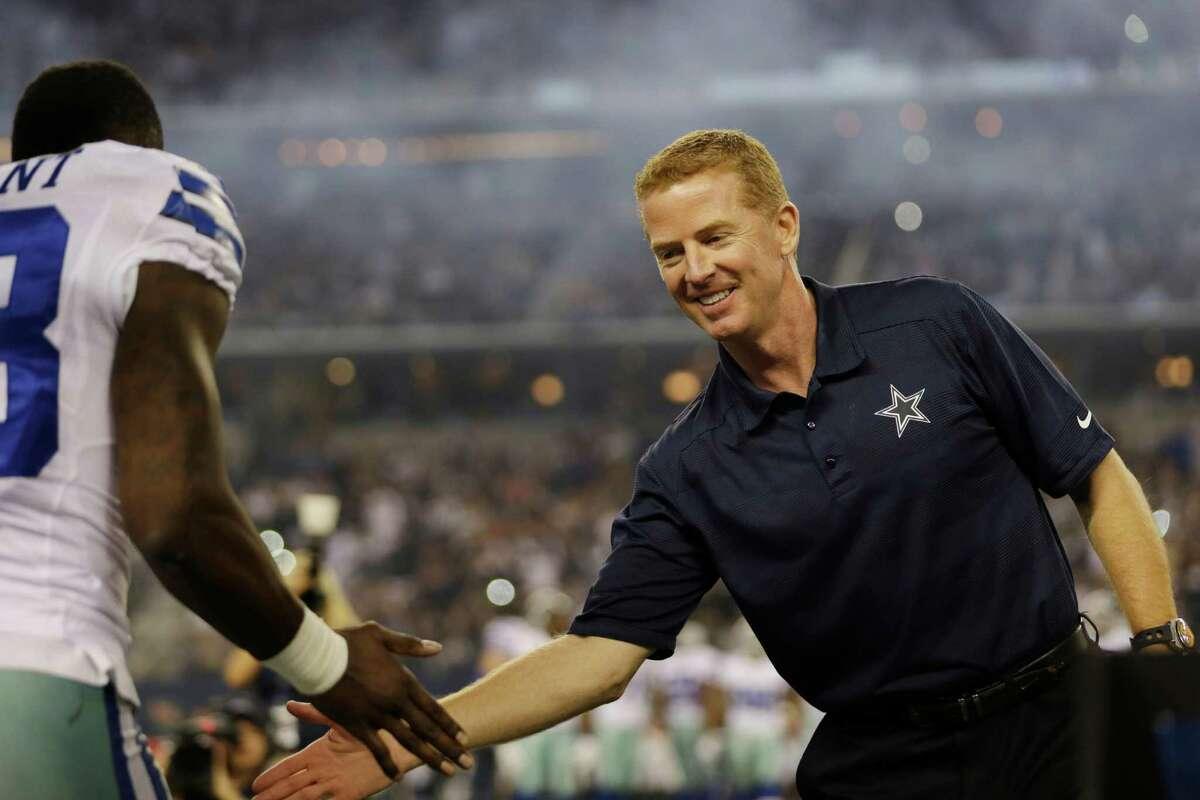 Dallas Cowboys head coach Jason Garrett greets wide receiver Dez Bryant before an NFL football game against the Philadelphia Eagles, Sunday, Dec. 29, 2013, in Arlington, Texas.
