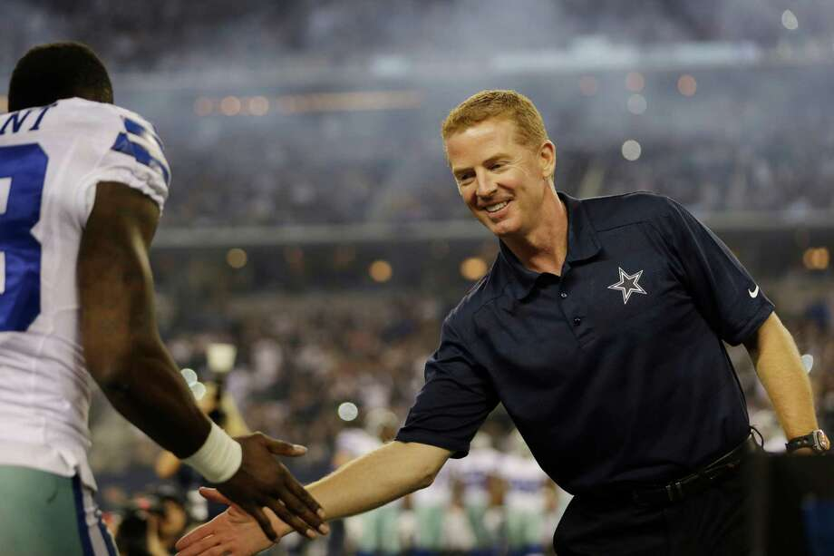 Dallas Cowboys head coach Jason Garrett greets wide receiver Dez Bryant before an NFL football game against the Philadelphia Eagles, Sunday, Dec. 29, 2013, in Arlington, Texas. Photo: Tim Sharp, AP / FR62992 AP