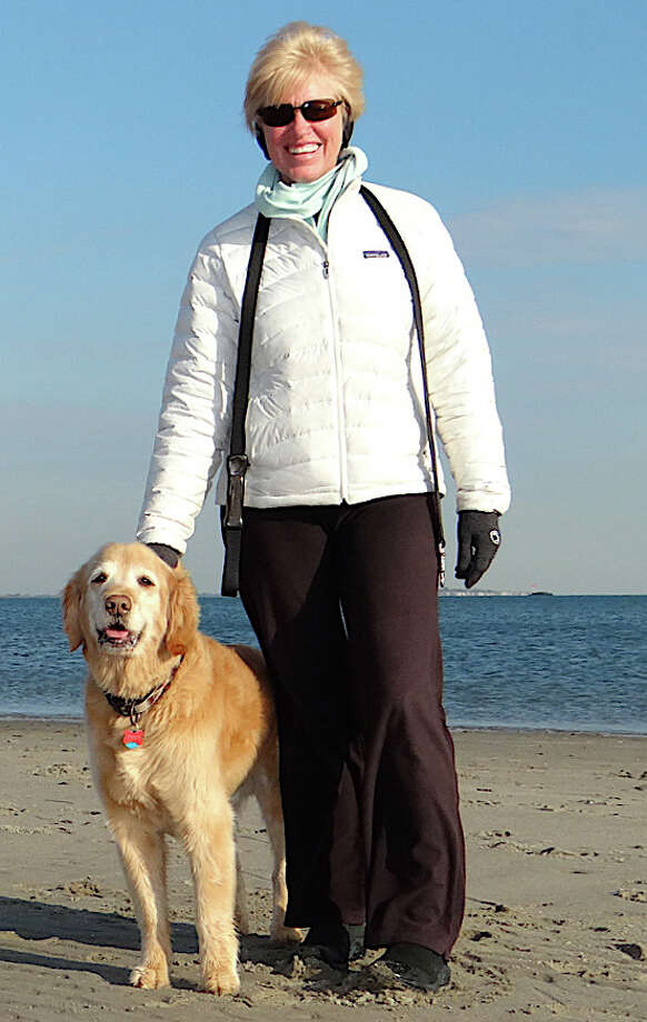 Joan Bechtold of Southport and her Golden Retriever, Toby, for a brisk walk on Penfield Beach. Photo: Mike Lauterborn / Fairfield Citizen contributed