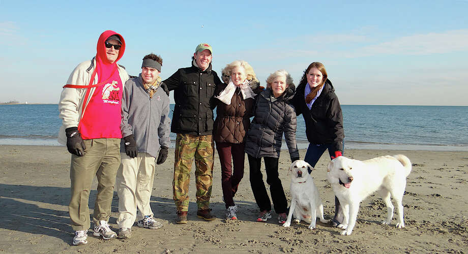 Mark Warns Sr., Mark Warns Jr., Trip Emerson, Ellen Emerson, Lynne Warns and Liz Emerson, from Baltimore, Md., and Monroe, with dogs Ziggy and Abby, at Penfield Beach. Photo: Mike Lauterborn / Fairfield Citizen contributed