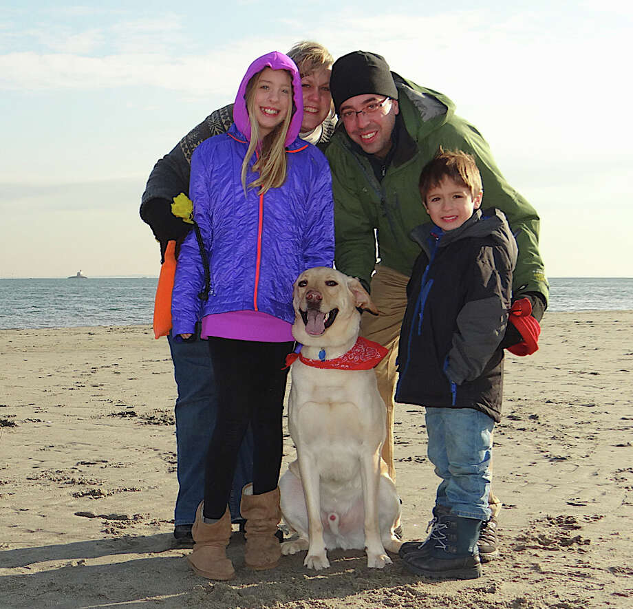 The Kenney Family of Fairfield -- Riley, 10; Stacie; Sean, 5, and Chris -- with their dog, Truman, at Penfield Beach. Photo: Mike Lauterborn / Fairfield Citizen contributed