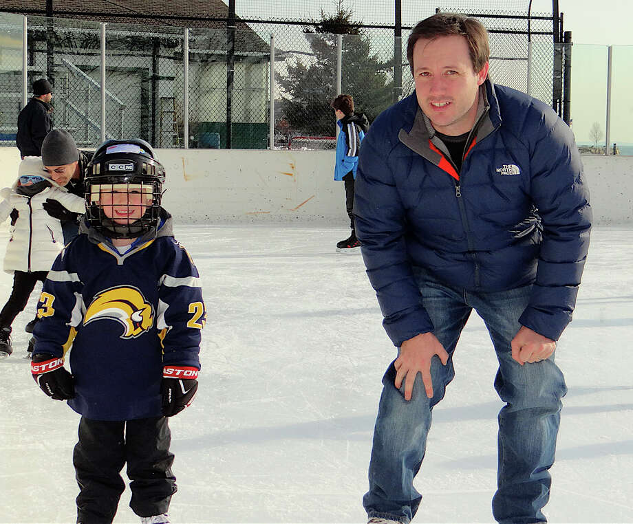 Ryan Driscoll of Monroe and son son Parker, 4, skating at the Westport PAL rink. Photo: Mike Lauterborn / Westport News contributed