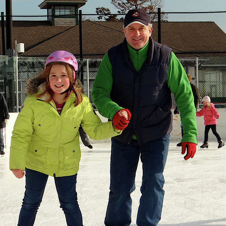 Mark Lindeis and daughter Anna, 10, skate together at the Westport PAL rink. Photo: Mike Lauterborn / Westport News contributed