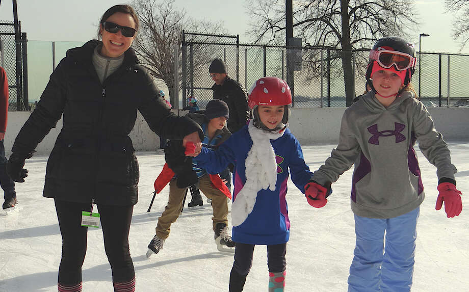 Marianne Wallace of Fairfield skates with daughters Sarah, 8, and Catherine, 10, on Friday at the Westport PAL rink in Longshore Park. Photo: Mike Lauterborn / Westport News contributed