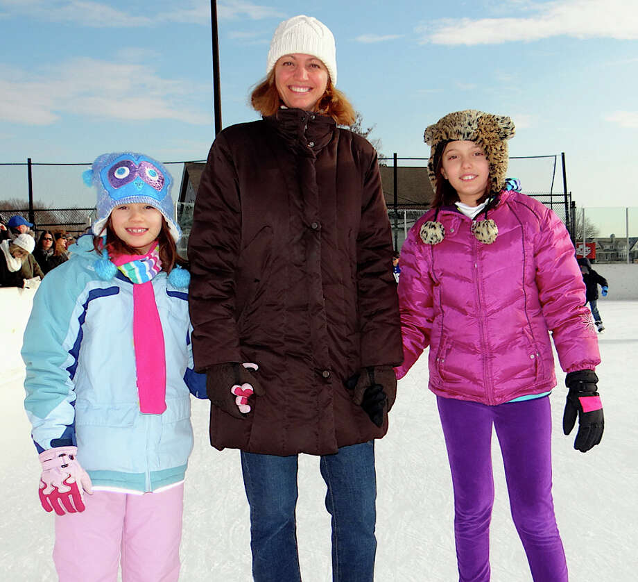 Arleen Kardos skating with daughters Gwendolyn, 8, and Alexandra, 11, on Friday. Photo: Mike Lauterborn / Westport News contributed
