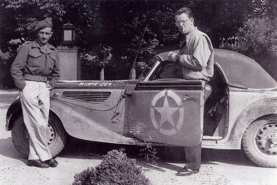 Army Capt. Michael Wales from Troy, right, holding door open of a captured BMW convertible in Germany when he was part of MP's. (Michael Wales)