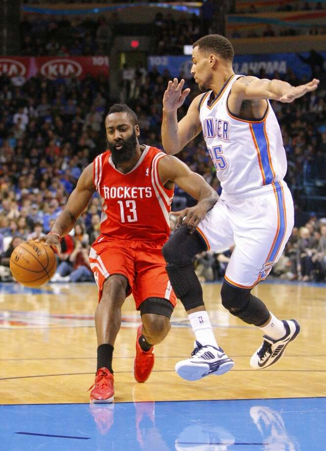 Dec. 29: Thunder 117, Rockets 86Rockets guard James Harden, left, drives to the basket around Thunder guard Thabo Sefolosha. Photo: Alonzo Adams, Associated Press