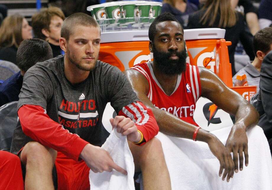 Rockets forward Chandler Parsons, left, and guard James Harden, right, sit on the bench. Photo: Alonzo Adams, Associated Press