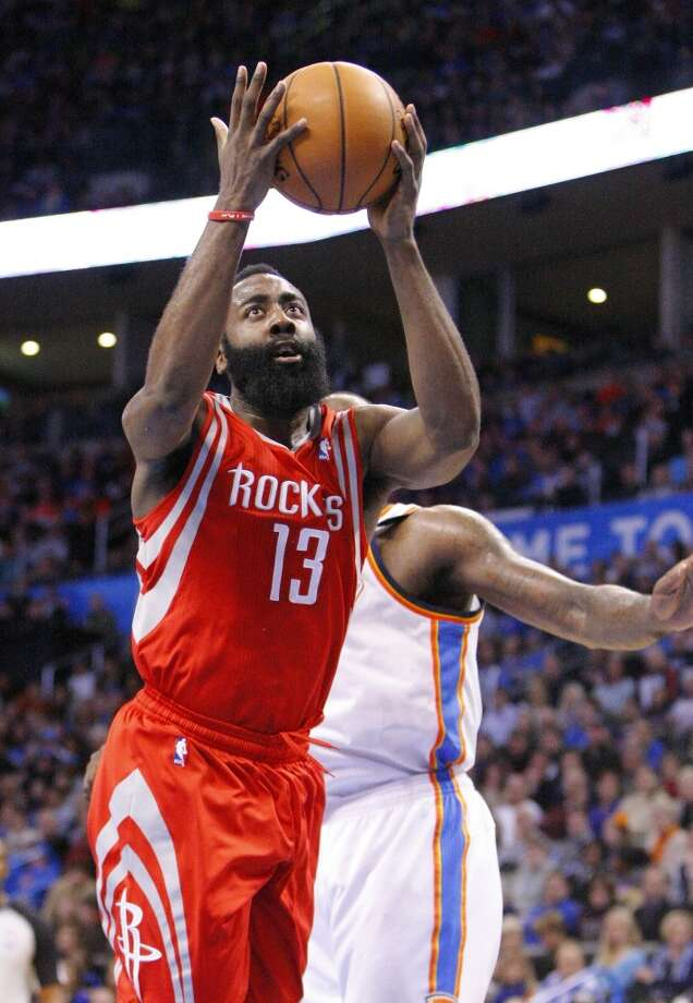 Rockets guard James Harden (13) shoots. Photo: Alonzo Adams, Associated Press