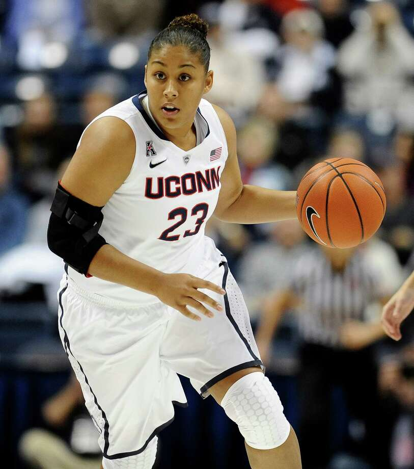 Connecticut's Kaleena Mosqueda-Lewis drives up the court during the first half of an NCAA college basketball game against Cincinnati, Sunday, Dec. 29, 2013, in Storrs, Conn. Photo: Jessica Hill, AP / Associated Press