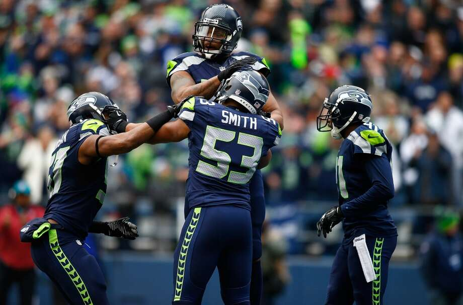 """2. Seattle got back to playing Seahawks footballGoing into the season, most people already knew the Seahawks' formula for success: run the ball with Marshawn Lynch and play a suffocating brand of defense that emphasizes takeaways to put Russell Wilson and the rest of the offense in good situations.But it didn't always go that way this season. The team sometimes abandoned the run too early, and teams were able to key on Wilson and bring a lot of pressure his way. The defense, too, had some uncharacteristic hiccups, most notably at St. Louis in a 14-9 Week 8 victory that the Rams should have won.But Sunday, the Hawks got back to playing their brand of football. """"Today's effort was really Seahawks football,"""" Carroll said after the game. """"It was really like we like it.""""It certainly was. Lynch came up 3 yards short of his first 100-yard rushing game since Nov. 10 against the Falcons, routinely gashing the Rams for gains up the middle and outside. That took the pressure off of Wilson, who played an efficient — if not spectacular — game.But the defense played with a real spark on Sunday, setting the tone early with Malcolm Smith's 37-yard interception return for a touchdown and holding the Rams to a measly 13 yards rushing all game -- after giving up over 200 in that first matchup in St. Louis. A late Rams touchdown Sunday marred what was otherwise a dominating performance, one of the Seahawks' best all season long.It's the kind of win that bodes well for the postseason, because if the Seahawks enter the playoffs playing their brand of football, the rest of the league is in big trouble.— Stephen Cohen Photo: Jonathan Ferrey, Getty Images"""