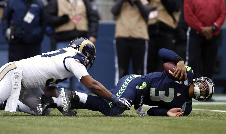 3. The offensive line is still a big problem  Last year, left tackle Russell Okung was a Pro Bowler. This year, having missed eight games with turf toe and likely still feeling the effects, Okung has taken a step back. It was never more apparent than Sunday, when he struggled all day against a Rams defensive line that is one of the best in the league. Okung consistently lost his battles with St. Louis defensive end Robert Quinn, and even nullified a Seahawks touchdown when he was caught holding Quinn just before halftime.  Marshawn Lynch had little success running to the left, finding more room up the center or to the right around right tackle Breno Giacomini. And while it appeared that the return of right guard J.R. Sweezy helped the Hawks, they still had trouble fending off the dangerous St. Louis pass-rush. Like the Cardinals last week, and the 49ers three weeks ago, the Rams found success rushing Russell Wilson from the outside and containing him in the pocket. Wilson was sacked four times Sunday as he looked for receivers downfield.  The O-line has arguably been Seattle's biggest weakness all season, and it continues to be now. In fact, the offensive linemen haven't appeared to improve through the final few games of the season; if anything, they have regressed. And that is a big problem going into the playoffs, where Seattle won't face any bad opponents.   Sure, the Seahawks have a great defense -- perhaps one of the best in NFL history -- but they won't be able to win in the postseason if their offense doesn't step up. And based on what we've seen all season and saw once again Sunday, that success will largely depend on the O-line, which is tasked with opening running lanes for Lynch and protecting Wilson. For Seattle, no protection leads to no run game, which leads to no pass game, no offense, no points and no wins.  — Nick Eaton Photo: John Froschauer, Associated Press