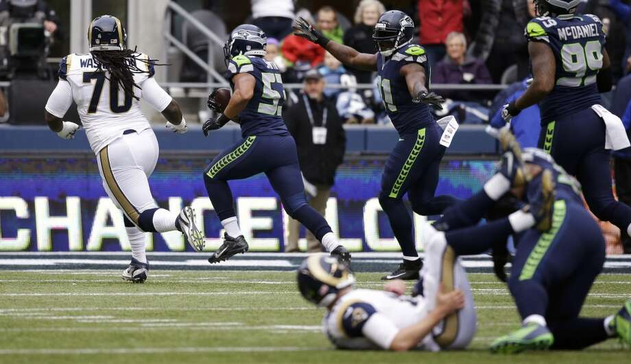 4. Early momentum is key at the CLinkA week ago, when the Arizona Cardinals came into CenturyLink Field and shocked the Hawks, one early play seemed to set the tone for the entire game: a 60-yard pass that nearly went for a touchdown, on Arizona's first possession, deflated the 12th Man and set a cloud over the CLink. From that point on, it seemed the Seahawks had to claw back into the game; Seattle's offense sputtered and the fans freaked.Indeed, things began somewhat similarly Sunday against the Rams -- at least when it came to the Seahawks' offense. The game began with a three-and-out on Seattle's first drive, and St. Louis then got going with a couple of first downs. Surely some of the 12th Man was starting to get nervous about the Hawks' ability to shut down the Rams in the most important game of the season.That all changed when linebacker Malcolm Smith picked off Rams quarterback Kellen Clemens and took it 37 yards to the end zone, putting Seattle up 7-0 early in the first quarter. The 68,274 fans at CenturyLink Field went wild, the Seahawks appeared to loosen up and rode that momentum all the way to the final whistle. Seattle's famously suffocating home-field advantage returned to the CLink just in time for the playoffs.The 12th Man's energy will be key for the Seahawks in the postseason. With the victory Sunday, Seattle clinched the NFC's No. 1 playoff seed, giving them a first-week bye and home-field advantage throughout the playoffs. No longer untouchable at home after the loss to Arizona last week, the Hawks ought to remember how important early momentum seems to be at the CLink, where Seattle sports fans have had to condition themselves throughout years of disappointment.— Nick Eaton Photo: Elaine Thompson, Associated Press