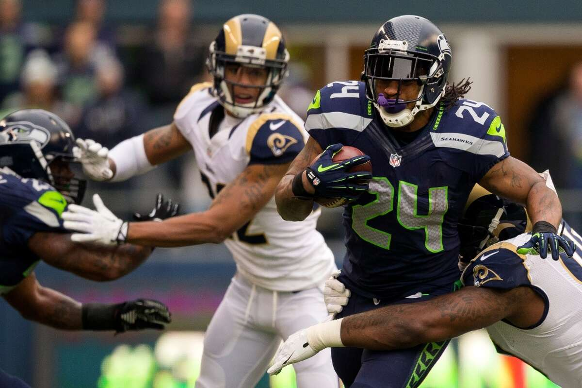 Seahawk Marshawn Lynch, center right, charges through Ram defense during the first half of the final regular season game Sunday, Dec. 29, 2013, at CenturyLink Field in Seattle. The Seahawks led the Rams 13-0 at the half. (Jordan Stead, seattlepi.com)