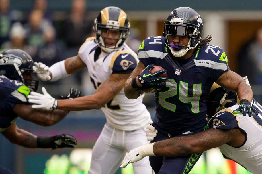 Seahawk Marshawn Lynch, center right, charges through Ram defense during the first half of the final regular season game Sunday, Dec. 29, 2013, at CenturyLink Field in Seattle. The Seahawks led the Rams 13-0 at the half. (Jordan Stead, seattlepi.com) Photo: JORDAN STEAD, SEATTLEPI.COM