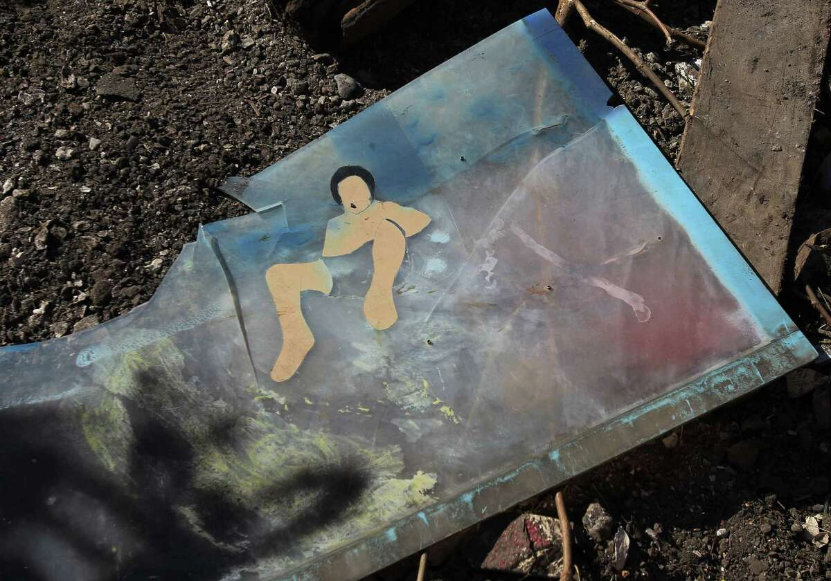 A nude woman is part of the business sign of La Costeñita bar. Steve Roskey rescued a mother and her infant, who was being held by sex traffickers as a way to coerce the victim into compliance.