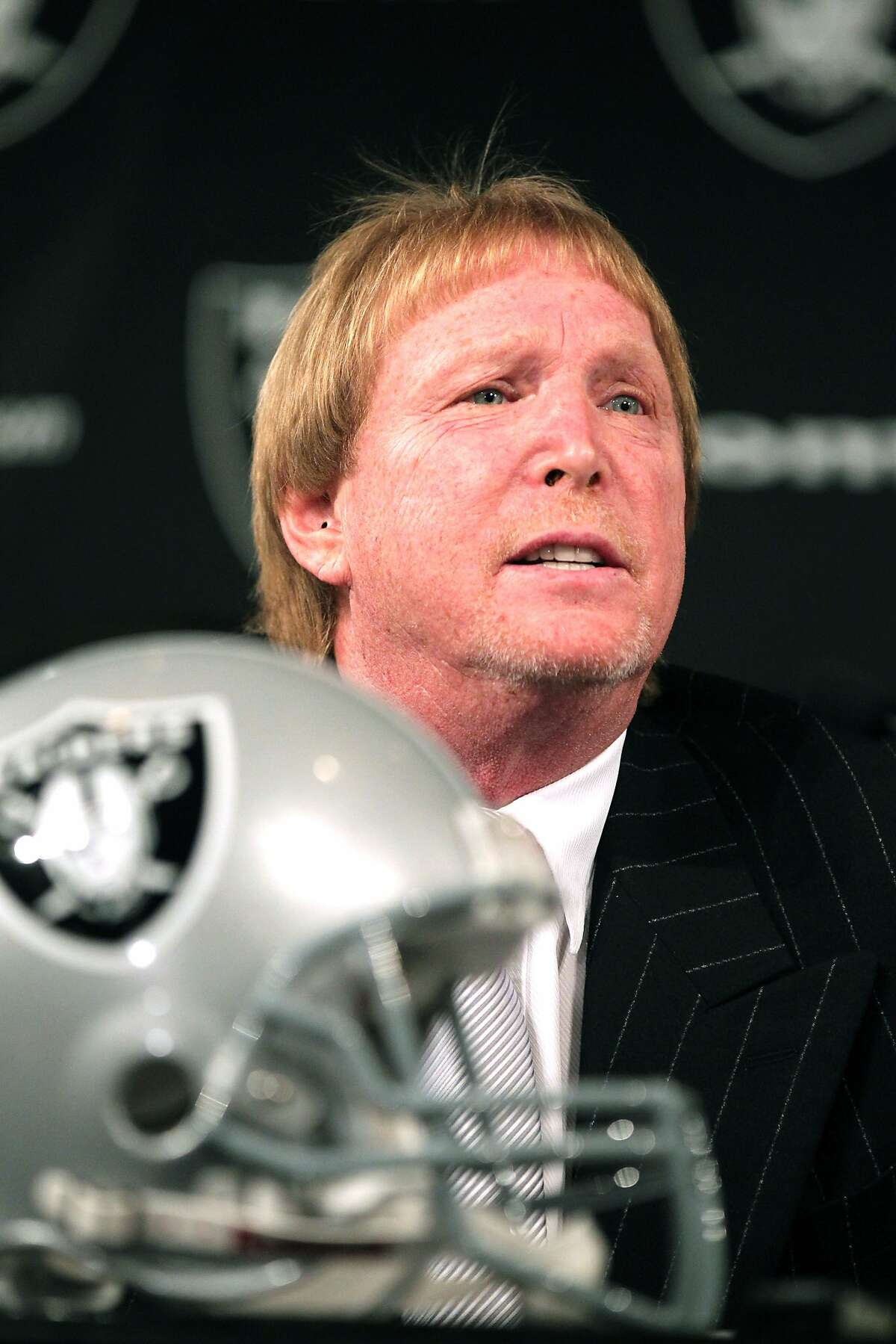 The Oakland Raiders owner Mark Davis listens to a question from the media. He introduced, Raiders new General Manager Reggie McKenzie at a press conference at Raiders headquarters in Oakland Tuesday, January 10, 2012
