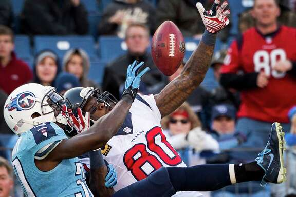 Titans cornerback Jason McCourty breaks up a second-half pass intended for Texans wide receiver Andre Johnson (80) on Sunday. With 49 yards receiving, Johnson fell 93 short of becoming the first NFL player with four seasons of 100 catches and 1,500 yards.