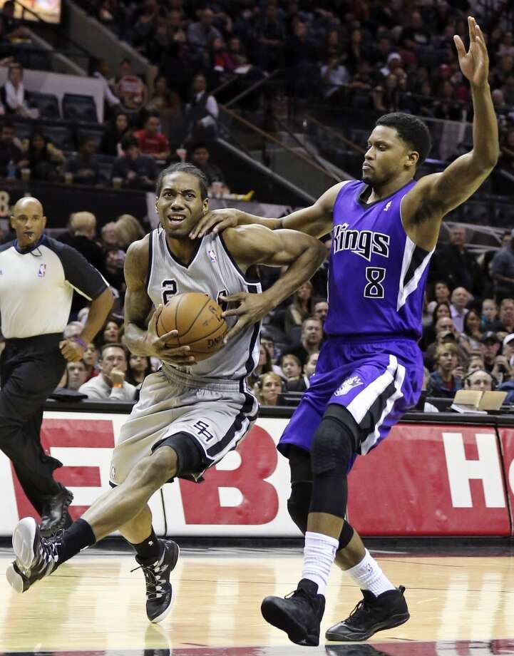 San Antonio Spurs' Kawhi Leonard looks for room around Sacramento Kings' Rudy Gay during first half action Sunday Dec. 29, 2013 at the AT&T Center. Photo: Edward A. Ornelas, San Antonio Express-News