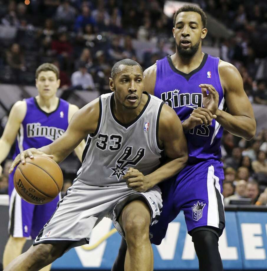 San Antonio Spurs' Boris Diaw looks for room around Sacramento Kings' Derrick Williams during first half action Sunday Dec. 29, 2013 at the AT&T Center. Photo: Edward A. Ornelas, San Antonio Express-News
