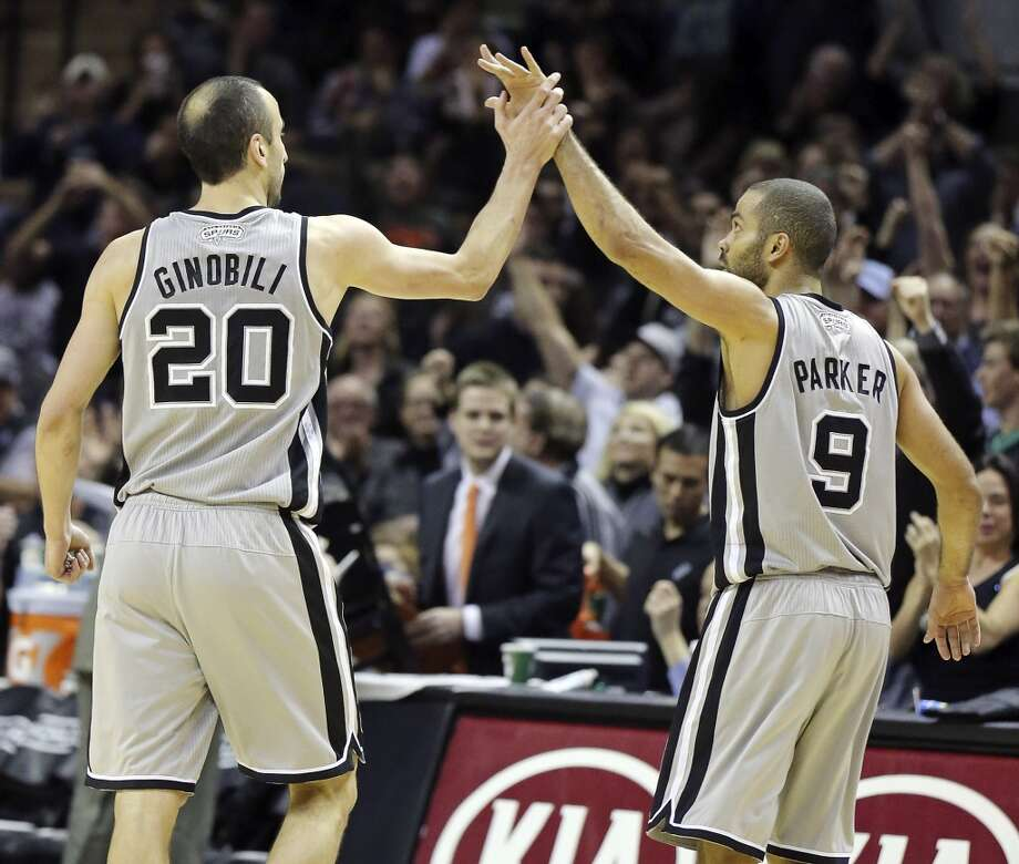 San Antonio Spurs' Manu Ginobili and San Antonio Spurs' Tony Parker celebrate after Parker made a 3-pointer during second half action against the Sacramento Kings Sunday Dec. 29, 2013 at the AT&T Center. The Spurs won 112-104. Photo: Edward A. Ornelas, San Antonio Express-News