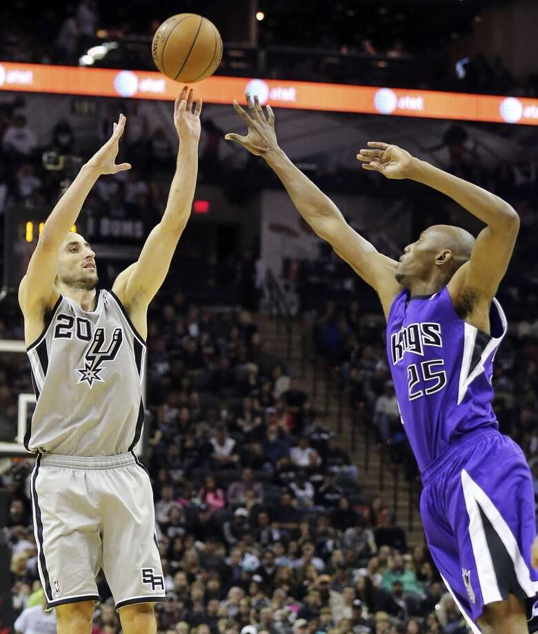 San Antonio Spurs' Manu Ginobili shoots over Sacramento Kings' Travis Outlaw during second half action Sunday Dec. 29, 2013 at the AT&T Center. The Spurs won 112-104. Photo: Edward A. Ornelas, San Antonio Express-News