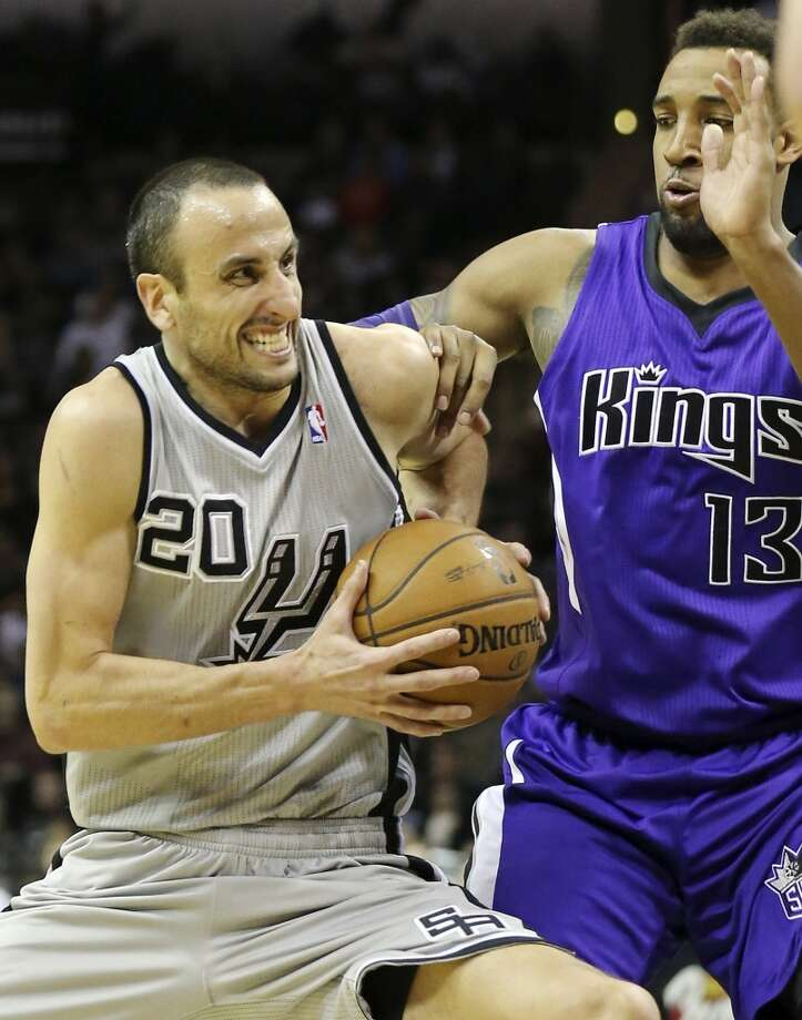 San Antonio Spurs' Manu Ginobili looks for room around Sacramento Kings' Derrick Williams during second half action Sunday Dec. 29, 2013 at the AT&T Center. The Spurs won 112-104. Photo: Edward A. Ornelas, San Antonio Express-News