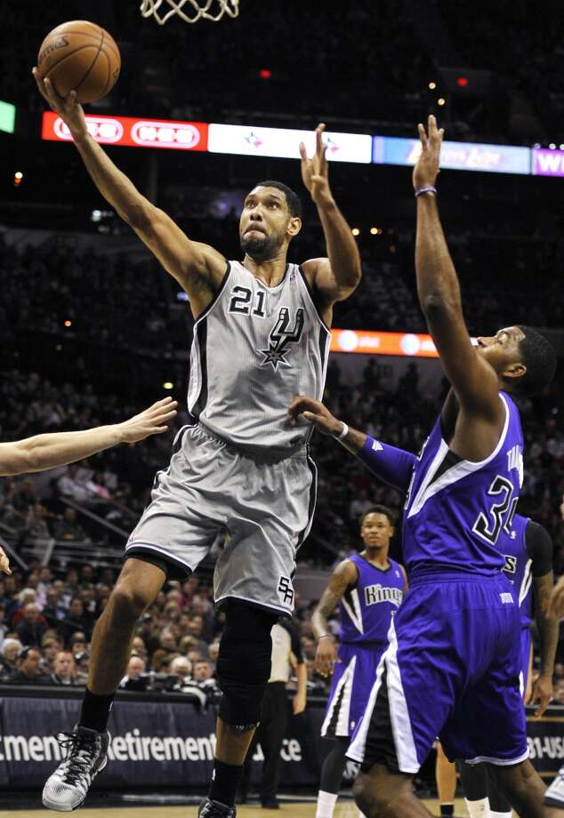San Antonio Spurs forward Tim Duncan, left, shoots against Sacramento Kings forward Jason Thompson during the first half of an NBA basketball game on Sunday, Dec. 29, 2013, in San Antonio. Photo: Darren Abate, Associated Press