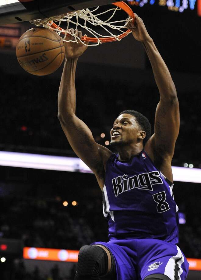 Sacramento Kings forward Rudy Gay dunks during the second half of an NBA basketball game against the San Antonio Spurs on Sunday, Dec. 29, 2013, in San Antonio. San Antonio won 112-104. Photo: Darren Abate, Associated Press