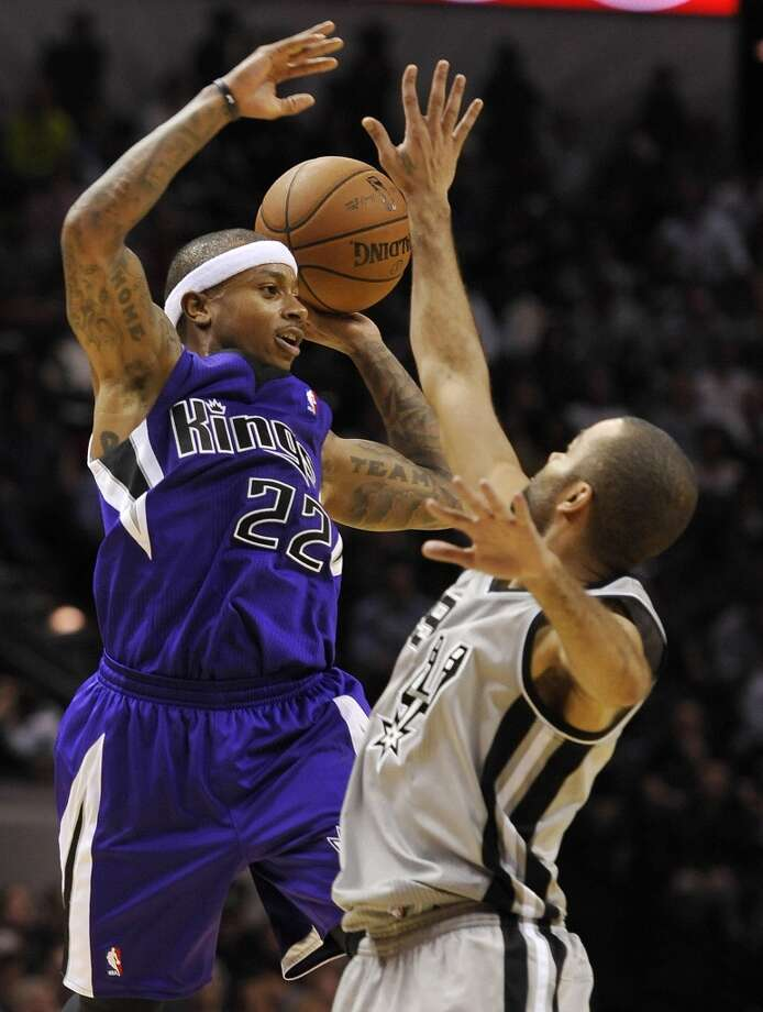 Sacramento Kings guard Isaiah Thomas, left, looks to pass around San Antonio Spurs guard Tony Parker, of France, during the second half of an NBA basketball game on Sunday, Dec. 29, 2013, in San Antonio. San Antonio won 112-104. Photo: Darren Abate, Associated Press