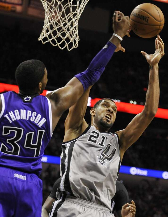 San Antonio Spurs forward Tim Duncan, right, chases a rebound against Sacramento Kings forward Jason Thompson during the second half of an NBA basketball game on Sunday, Dec. 29, 2013, in San Antonio. San Antonio won 112-104. Photo: Darren Abate, Associated Press