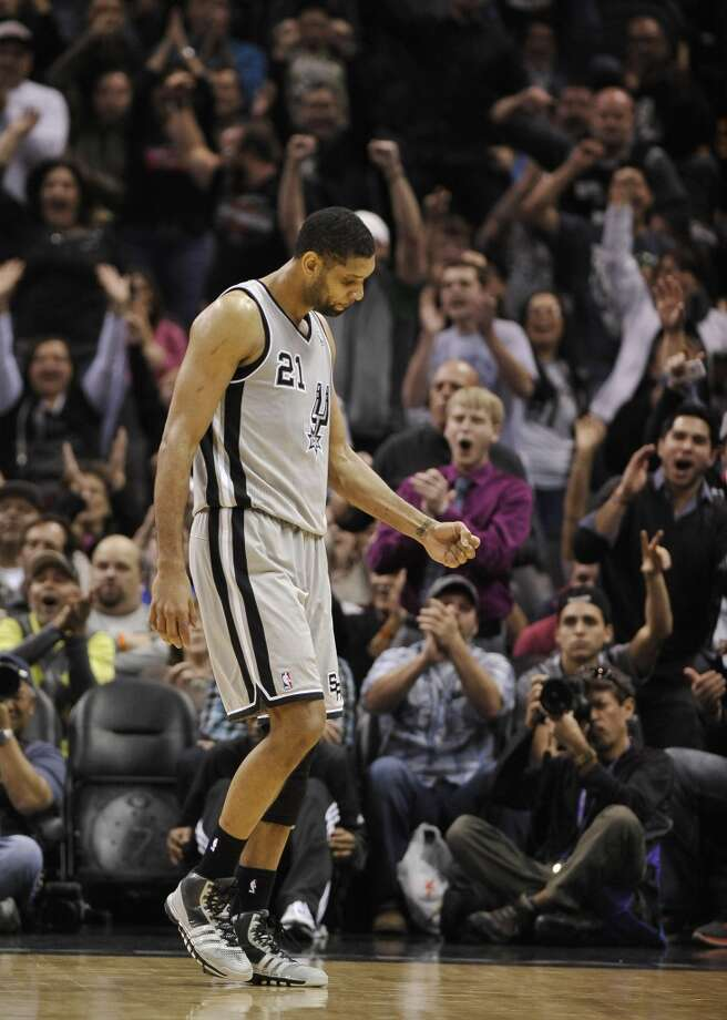 San Antonio Spurs forward Tim Duncan celebrates a basket in the closing minutes of an NBA basketball game against the Sacramento Kings on Sunday, Dec. 29, 2013, in San Antonio. San Antonio won 112-104. Photo: Darren Abate, Associated Press
