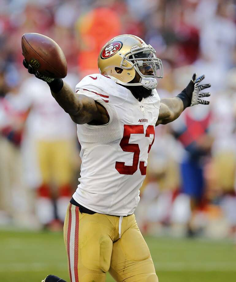 San Francisco 49ers inside linebacker NaVorro Bowman celebrates is fumble recovery against the Arizona Cardinals during the second half of an NFL football game, Sunday, Dec. 29, 2013, in Glendale, Ariz.  (AP Photo/Matt York) Photo: Matt York, Associated Press