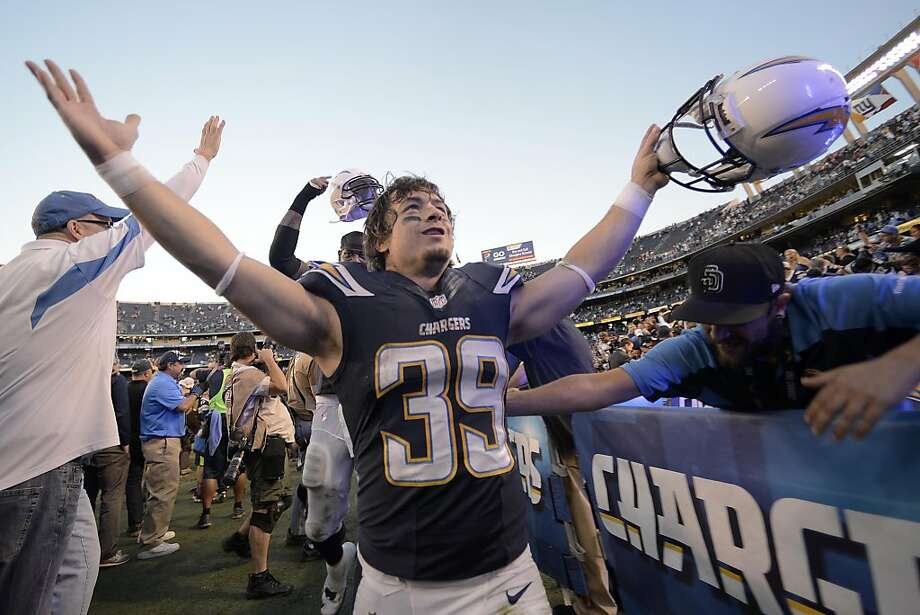 SAN DIEGO, CA - DECEMBER 29:  Danny Woodhead #39 of the San Diego Chargers celebrates a 27-24 overtime win against the Kansas City Chiefs during their game on December 29, 2013 at Qualcomm Stadium in San Diego, California. (Photo by Donald Miralle/Getty Images) Photo: Donald Miralle, Getty Images