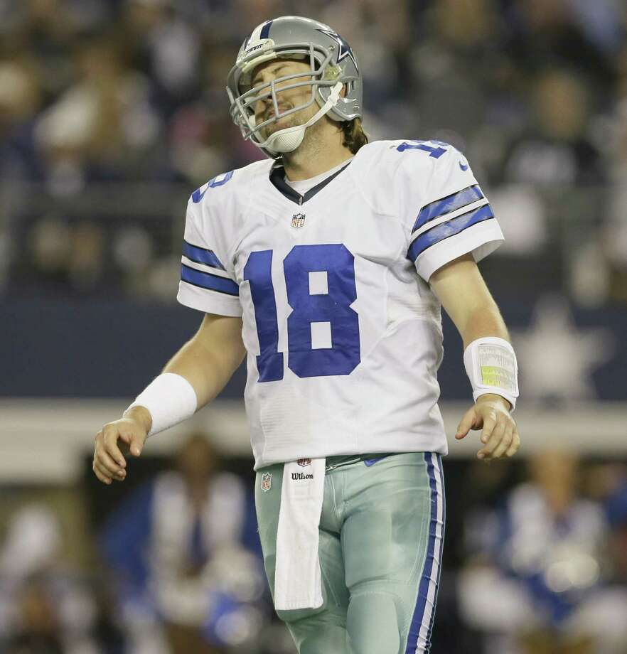 Cowboys QB Kyle Orton reacts to a play in the regular-season finale in Arlington. Orton was 30 of 46 for 358 yards with two TDs and two interceptions starting for an injured Tony Romo, but his late turnover helped end Dallas' season at 8-8. Photo: Tony Gutierrez / Associated Press / AP