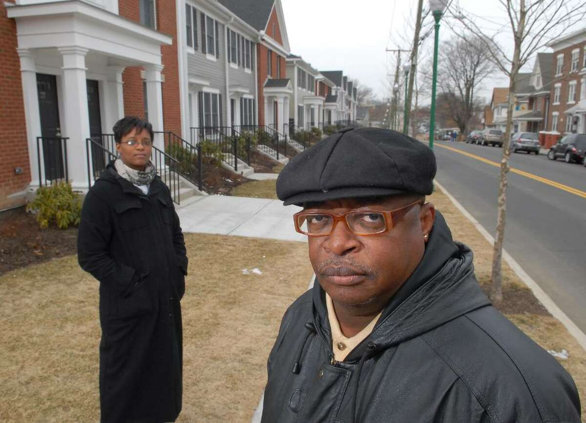 Sandra Thompson and Herb Lindgar, left to right, both former work-order dispatchers for Charter Oak Communities, the city's housing authority, pose in front of Fairgate Housing complex on Fairfield Ave., in Stamford, Tuesday, Feb. 2nd, 2010. Both were recently laid-off from the Housing Authority and are fighting to keep their jobs.