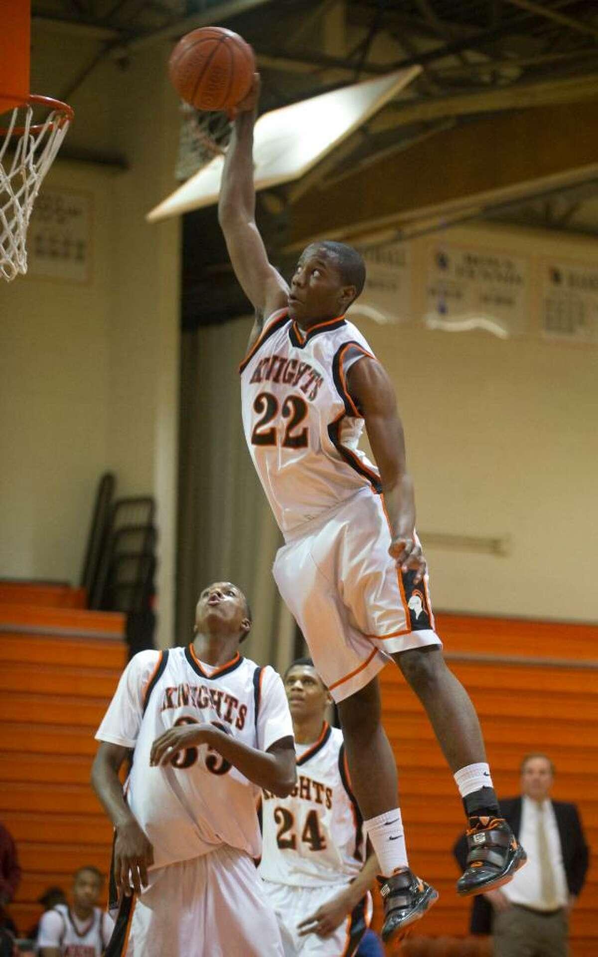 Stamford's Mark Ellis dunks during an FCIAC boys basketball game at Stamford High School in Stamford, Conn. on Tuesday, Feb. 2, 2010. Staples High School defeated Stamford High School 76-70 in overtime.