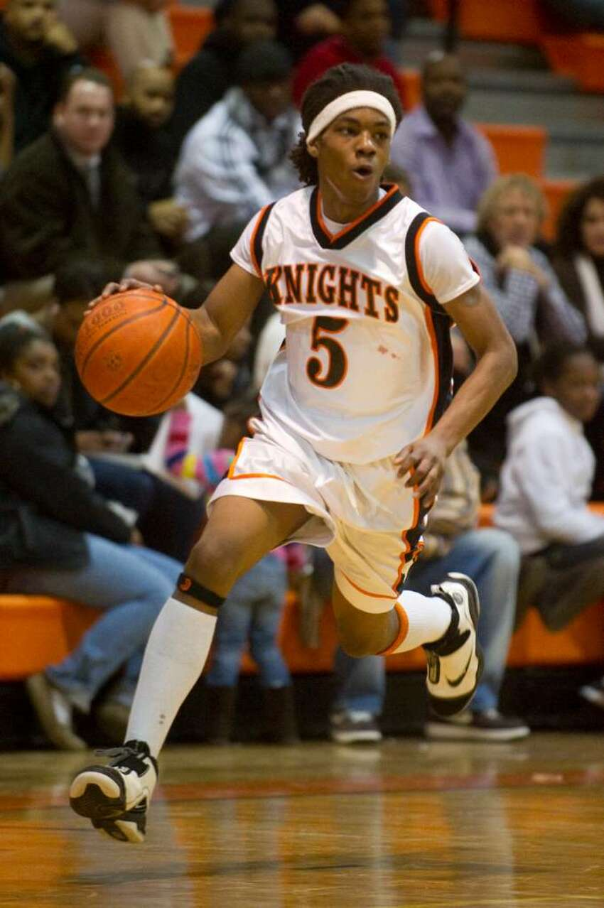 Stamford's Jakai Wilson, takes the ball downcourt during an FCIAC boys basketball game at Stamford High School in Stamford, Conn. on Tuesday, Feb. 2, 2010. Staples High School defeated Stamford High School 76-70 in overtime.