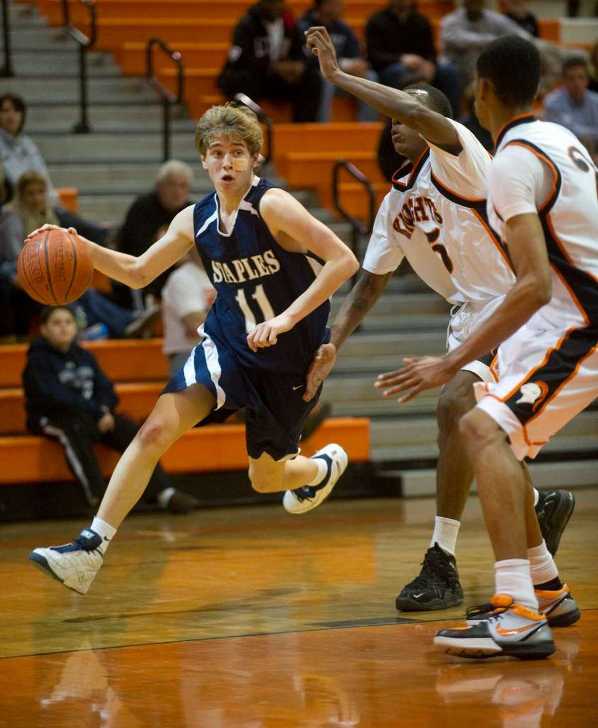 Staples' Luke Yeager drives to the hoop during an FCIAC boys basketball game at Stamford High School in Stamford, Conn. on Tuesday, Feb. 2, 2010. Staples High School defeated Stamford High School 76-70 in overtime.