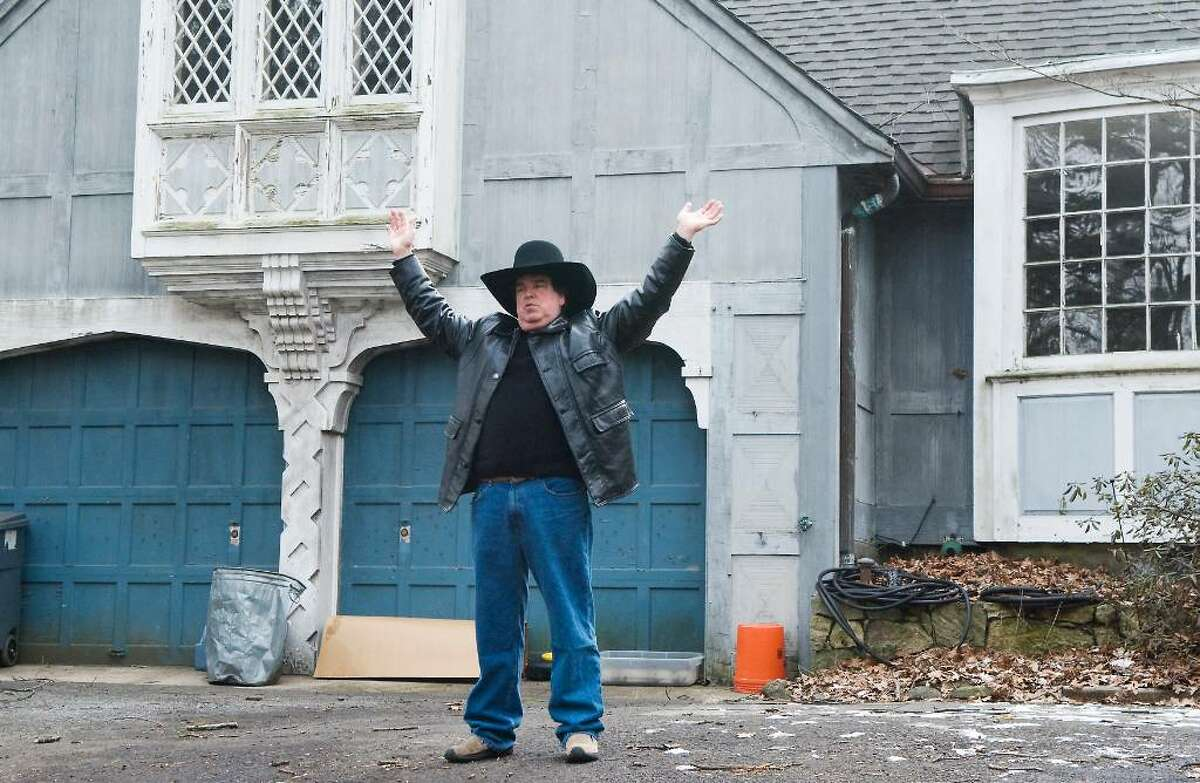 Scott Merrell, former Norwalk mayoral candidate, surrenders to Norwalk police as he is evicted from his house at 6 Woodland Road in Rowayton, Conn. on Tuesday, Feb. 2, 2010.