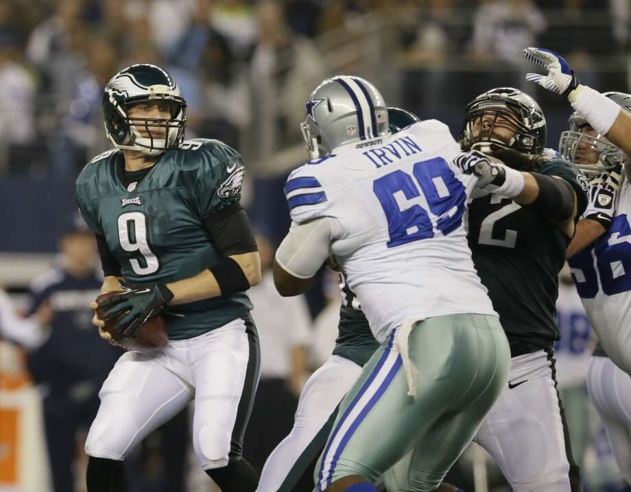 Philadelphia Eagles quarterback Nick Foles (9) looks to pass as Dallas Cowboys defensive tackle Corvey Irvin (69) is blocked during the first half of an NFL football game Sunday, Dec. 29, 2013, in Arlington, Texas. Photo: Tony Gutierrez, Associated Press
