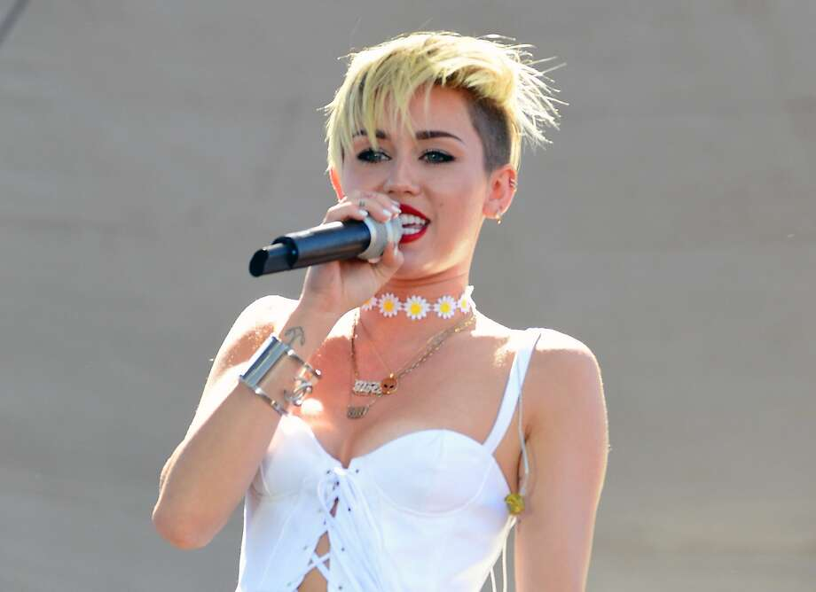 "FILE - In this Sept. 21, 2013 file photo, Miley Cyrus performs at IHeartRadio Music Village in Las Vegas, Nev. Cyrus' album ""Bangerz,"" out Tuesday, features guest spots from Big Sean, Nelly, Future and French Montana. She will host and perform on NBC's ""Saturday Night Live"" this week.  (Photo by Al Powers/Powers Imagery/Invision /AP, File) Photo: Powers Imagery, Associated Press"