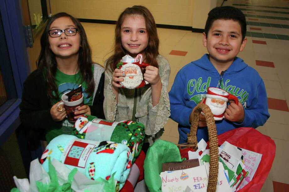 Spring ISD - $608 millionEnrollment: 36,028Debt outstanding per student: $16,881Pictured: Spring ISD's Anderson Elementary School third-graders Mirah Howard, Skylar Hartong and Ivaniel Diaz display mugs they made for charity in December. Photo: Spring Independent School District