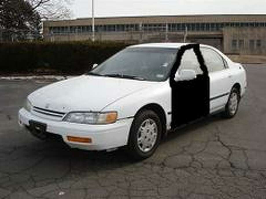 Melissa Rene Sowders is known to drive a white, 1995 Honda Accord, four-door similar to this one. Her car bears Texas license plate CL3H494 and the driver's door is black. Photo: Harris County Sheriff's Office