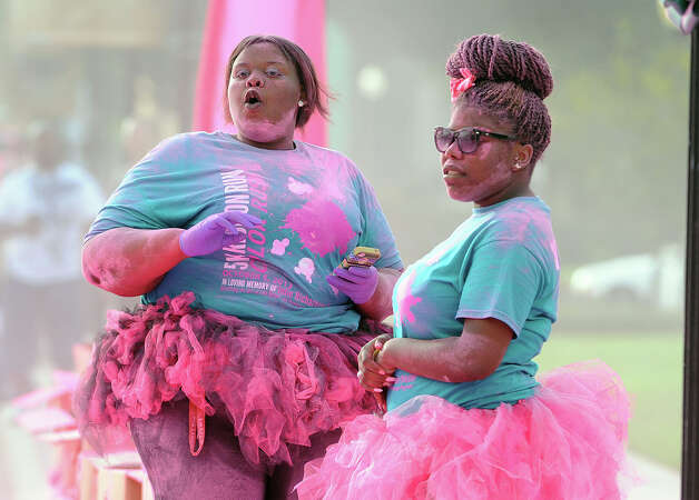 Participants in the Gift of Life 5K Ribbon Color Run trek through downtown Beaumont on Saturday. Runners finished the course covered in colored powder that was thrown on them during the run.