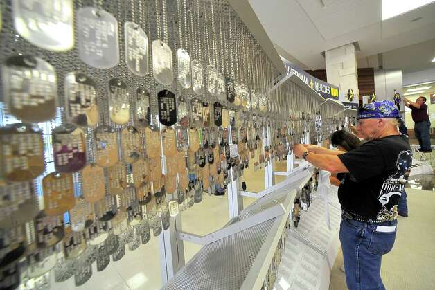 Veteran Billy Jack Kemp,works on the un-tieing and de-tangling  process of all the dog tags. Monday morning, the dog tags of 3417 Texas combat veterans, who died or are missing in action, during the Vietnam War, arrived in Beaumont escorted by the Patriot Guard Riders, Vietnam Veteran motorcyclists, the Jeeper Cub and others.  The The Texas Vietnam Heroes Exhibit will be housed in the lobby of the Edison Plaza for three weeks starting on Wednesday when it will open to the public at 10 am. Dave Ryan/The Enterprise Photo: Dave Ryan