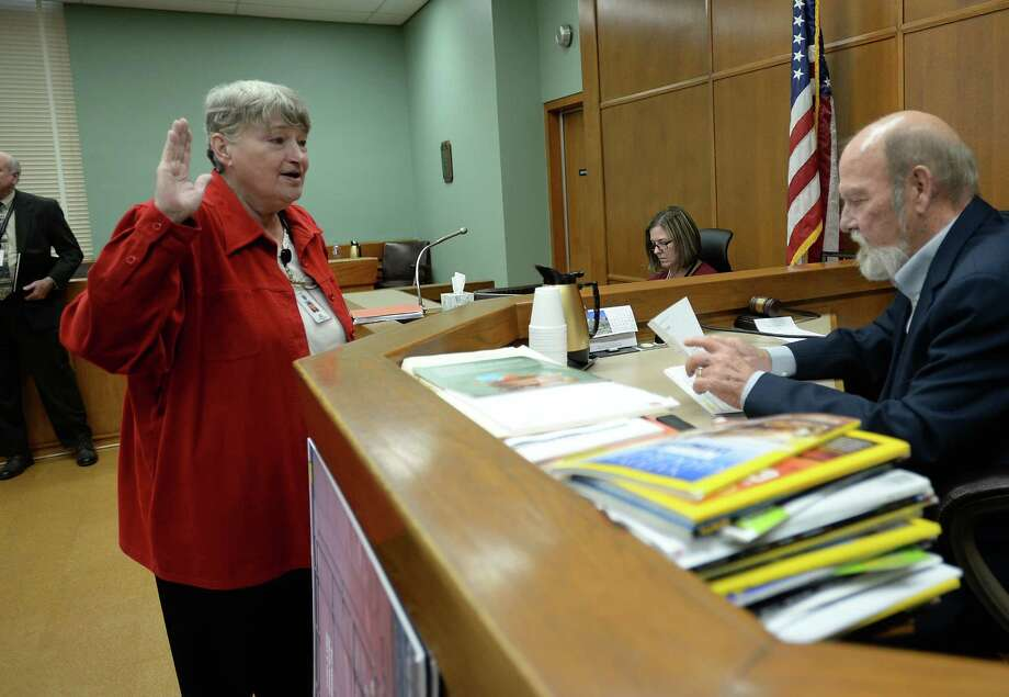 Jane Birge takes the oath in front of Judge Gary Sanderson Tuesday, October 22 to be Jefferson County's newest District Clerk. Birge will follow Lolita Ramos who recently passed away from cancer. Guiseppe Barranco/The Enterprise Photo: Guiseppe Barranco, Photo Editor
